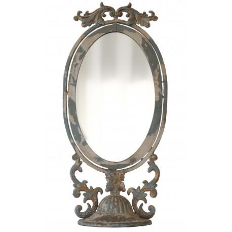 Grand miroir oval à poser en métal vieilli