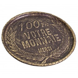 100 francs coin return tray