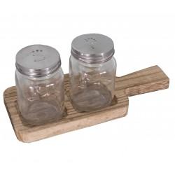 Présentoir sel et poivre sur une planche en bois