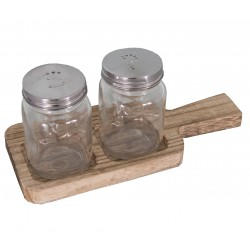 Salt and pepper display on a wooden board